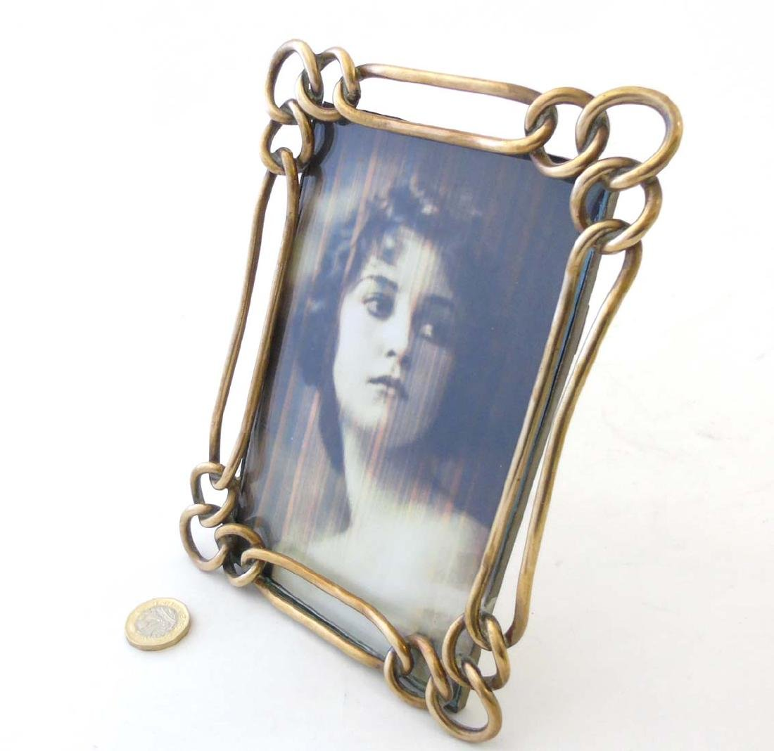 A late Victorian brass chain link photograph frame with