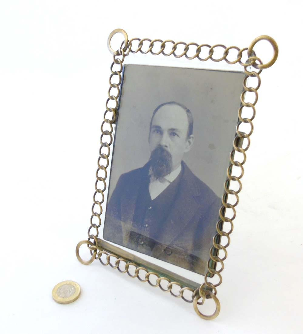 A c.1900 German flattened curblink frame with easel /