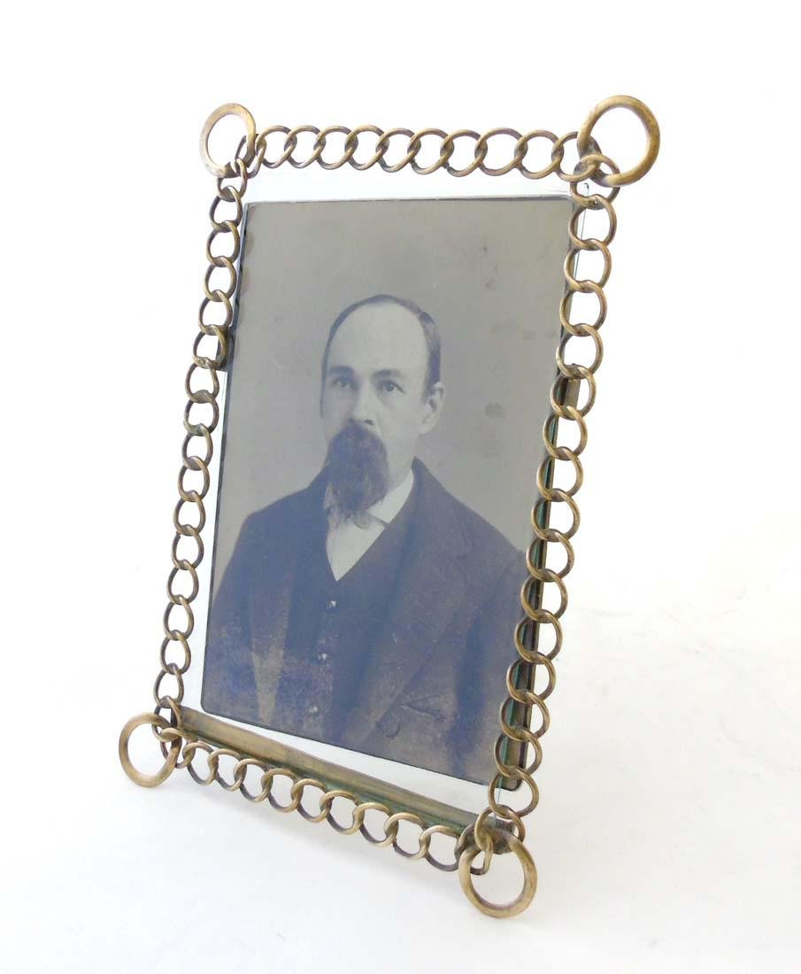 A c.1900 German flattened curblink frame with easel / - 2