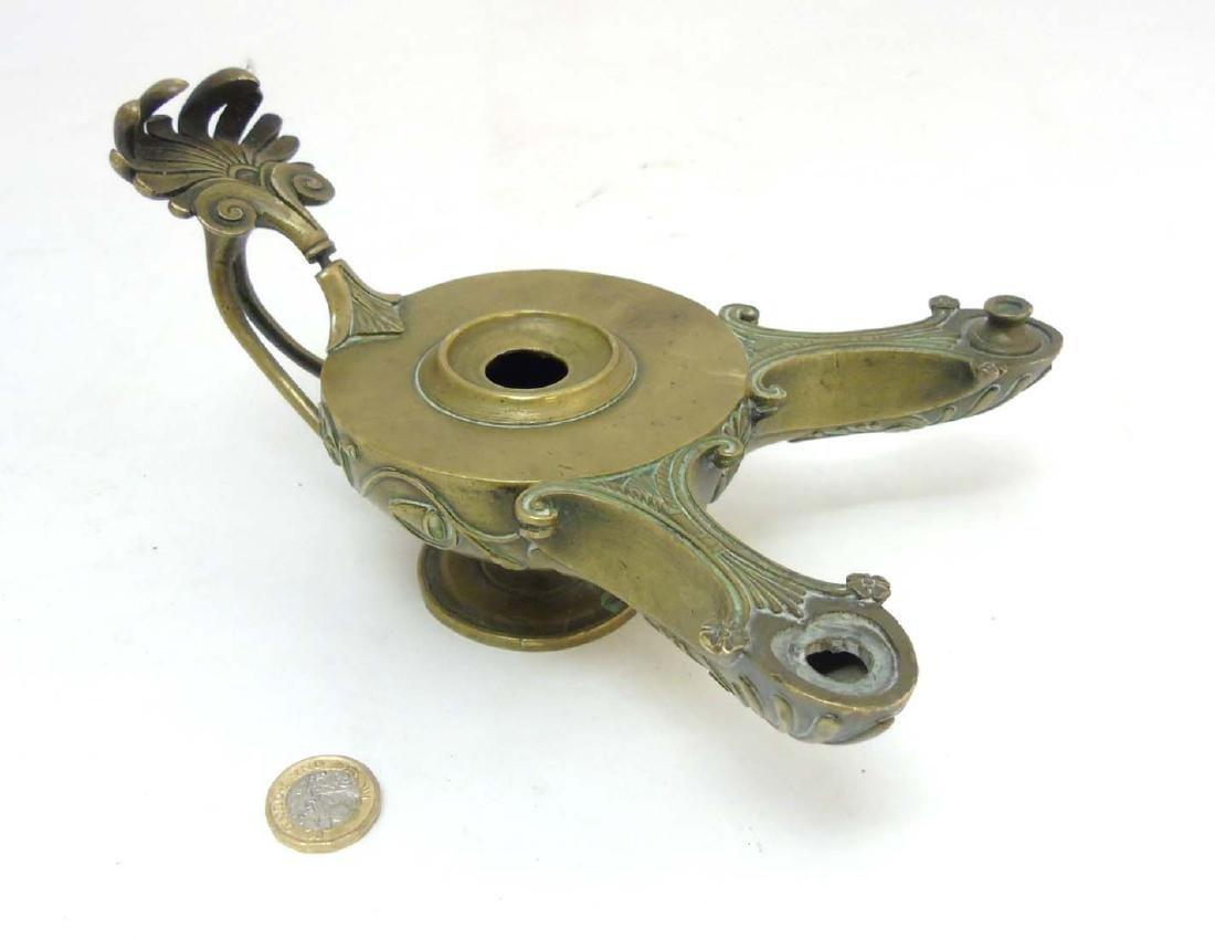 A Regency brass Romanesque 2- branch pedestal oil lamp