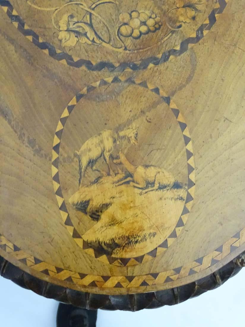 A 19thC black forest tilt top table with marquetry - 5