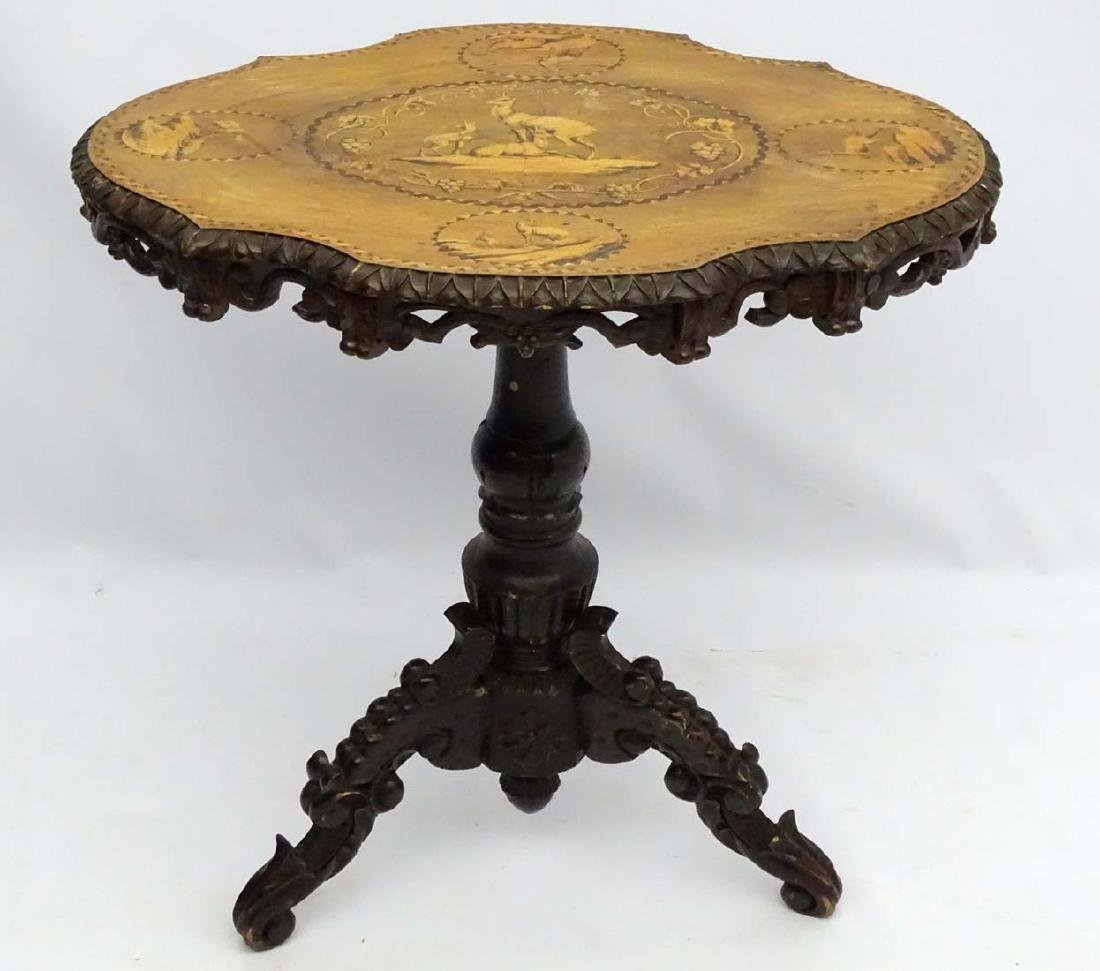 A 19thC black forest tilt top table with marquetry - 8