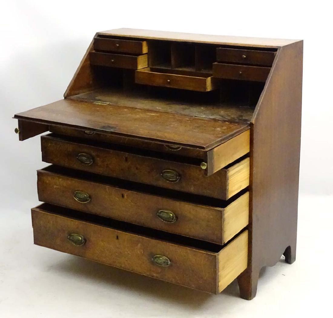 A Georgian oak bureau with four long drawers and a - 2