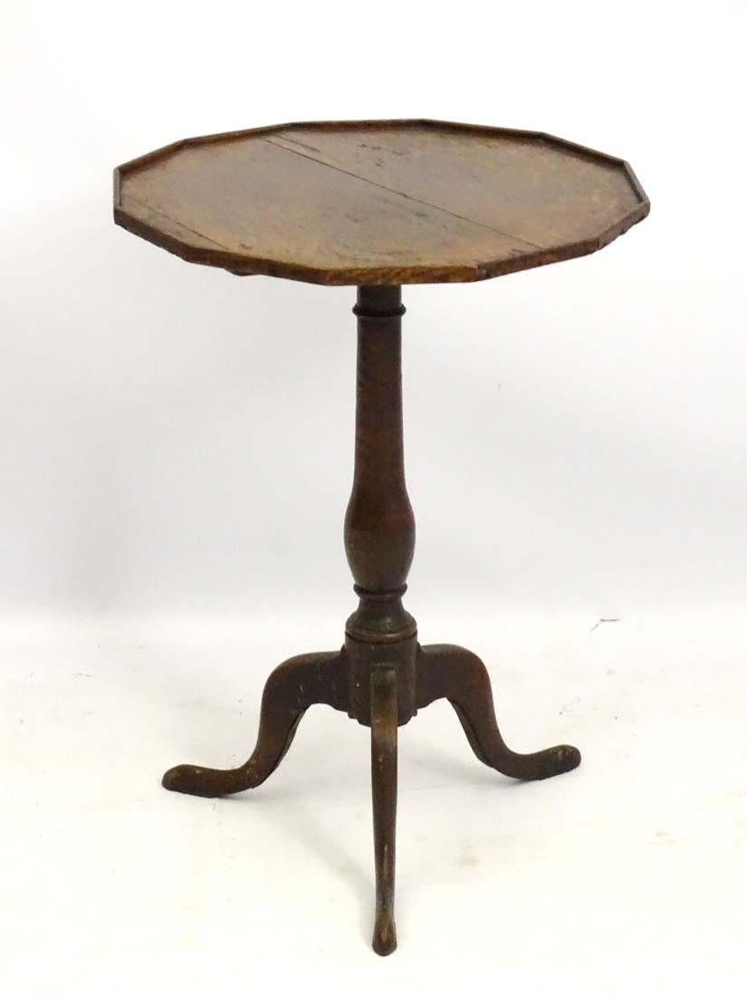 An early 19thC oak occasional table with a twelve sided