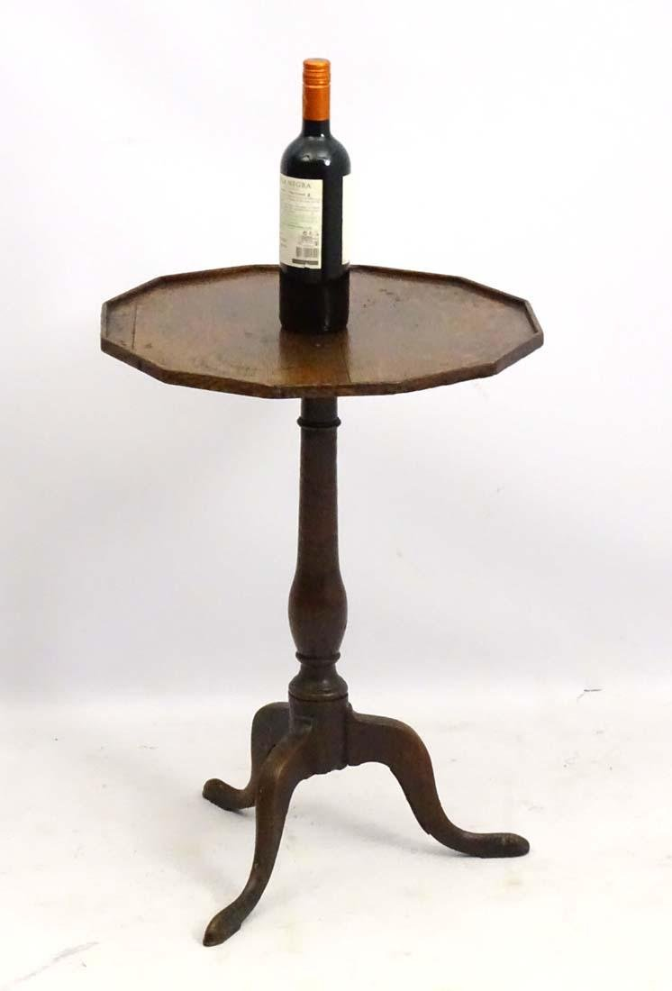 An early 19thC oak occasional table with a twelve sided - 2