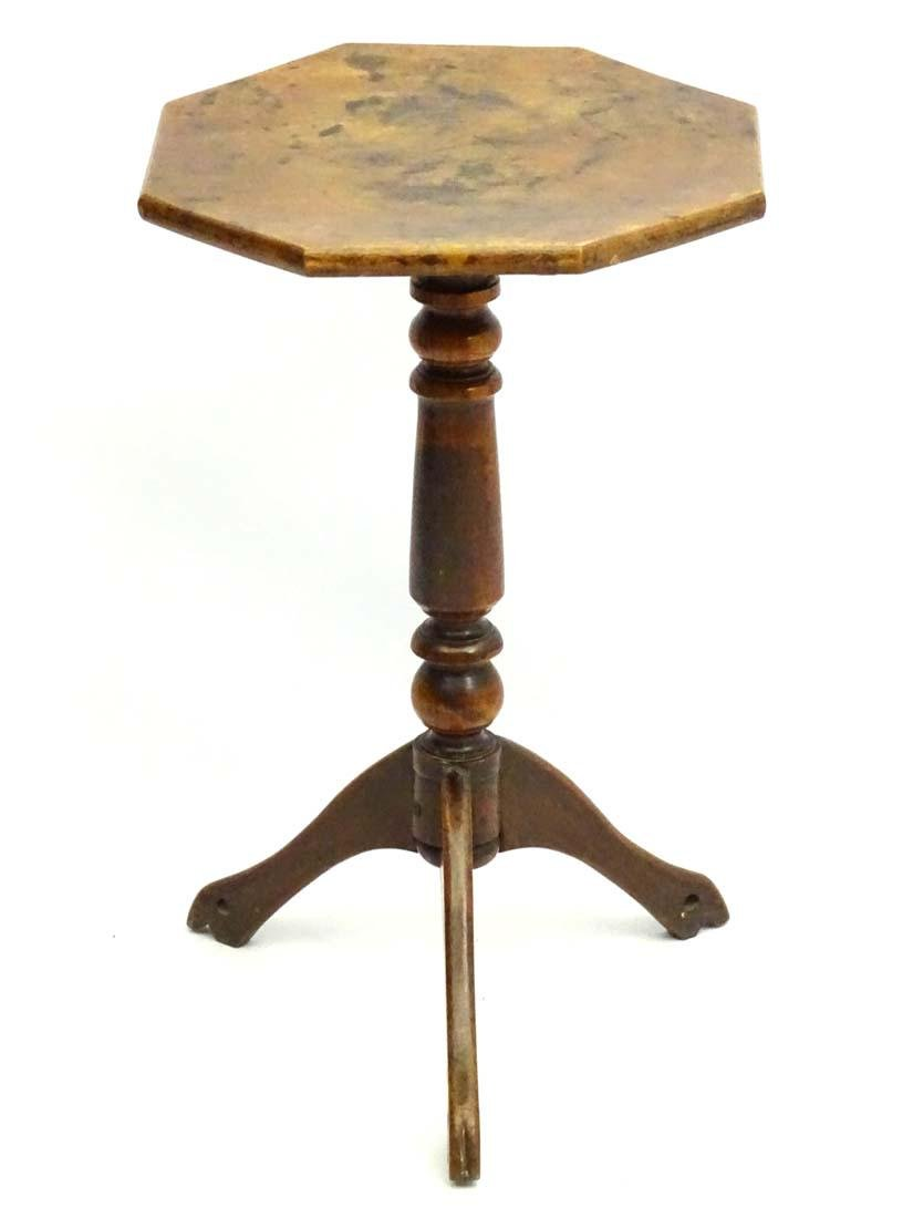 An early / mid 19thC fruitwood tripod table with