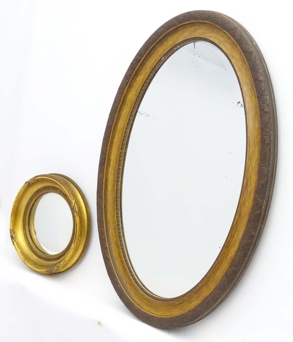 A Victorian gilt circular convex mirror together with