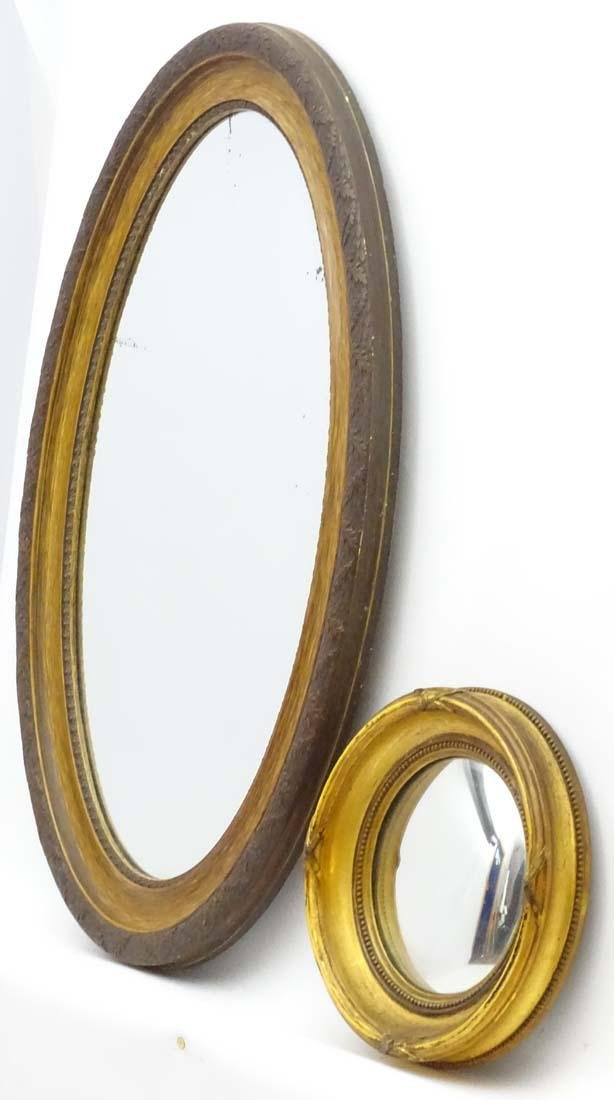 A Victorian gilt circular convex mirror together with - 3