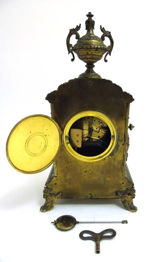 Brass ornate mantel clock  : A French ornate cased 8 - 10