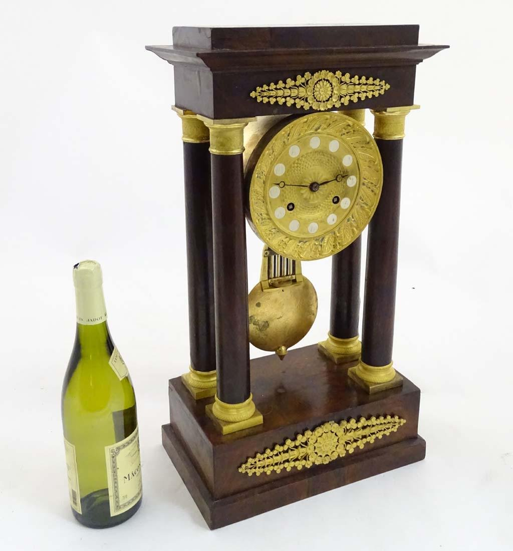French Empire Clock : an early 19 th c gilded and