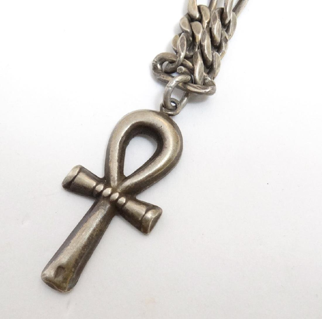A white metal chain necklace with cross pendant. Approx - 2