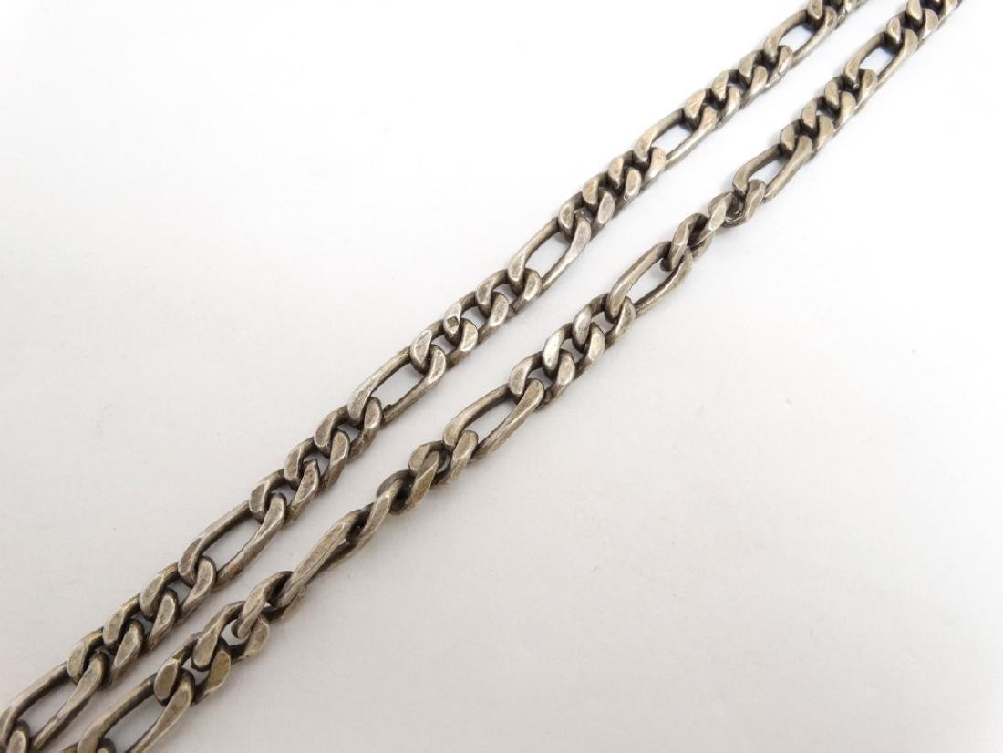 A white metal chain necklace with cross pendant. Approx - 4