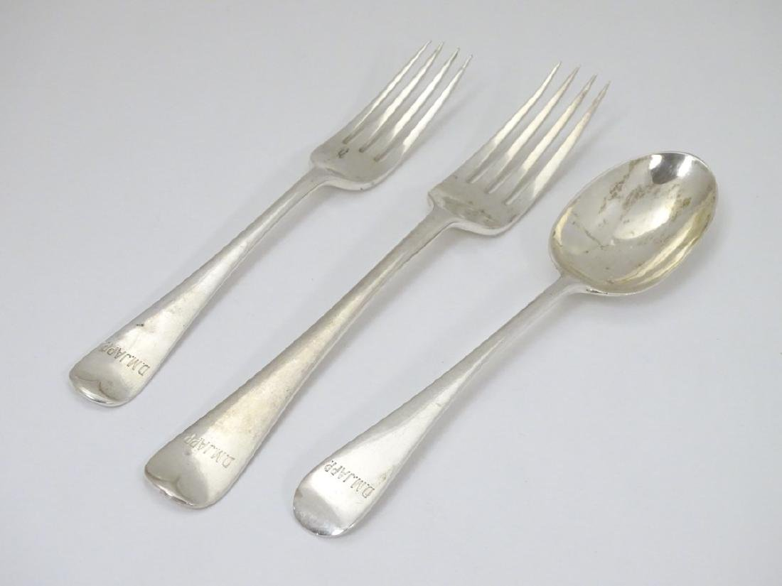A silver table fork, together with a dessert fork