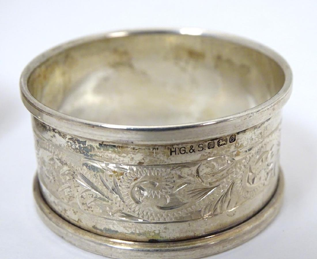 A pair of silver napkin rings hallmarked Sheffield 1976 - 7