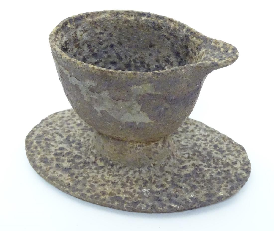 An unusual 19thC cast iron jugged vessel and oval stand