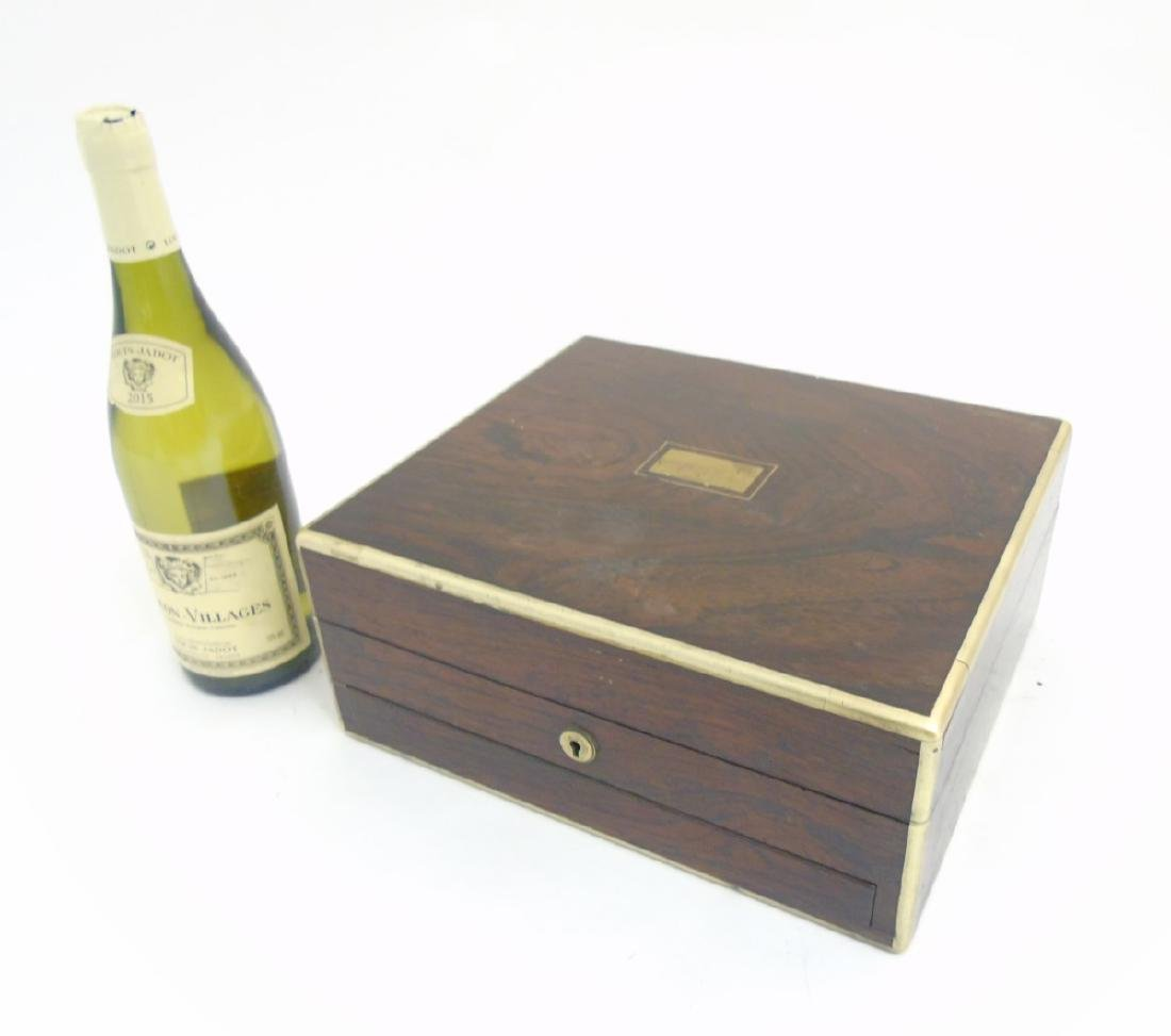 A 19thC Rosewood and brass cornered box with sprung