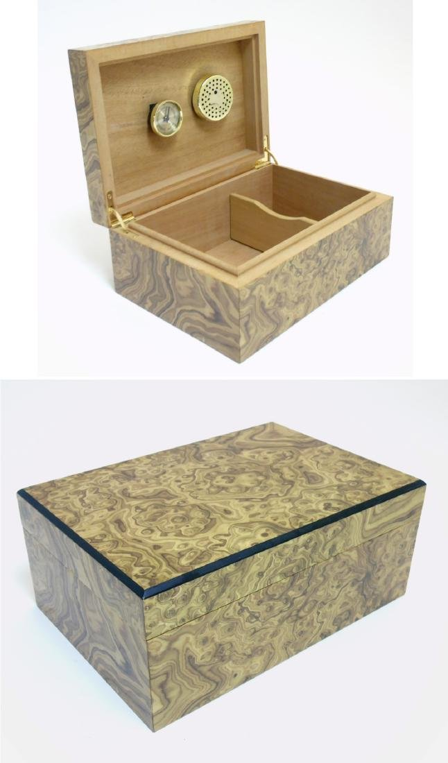 A mid - late 20thC burrwalnut (unstained) cigar humidor