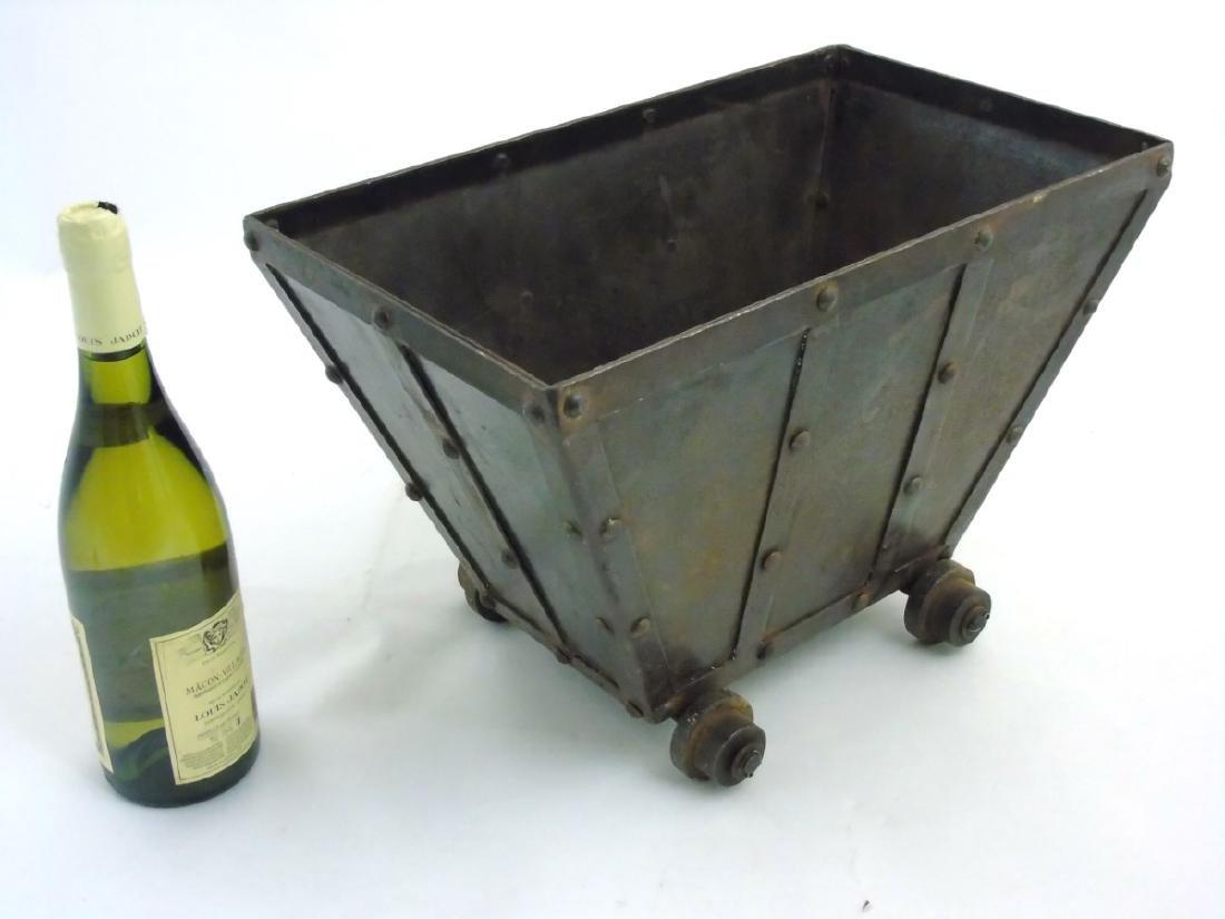 A circa 1900 Coal / log / waste paper bin formed as a