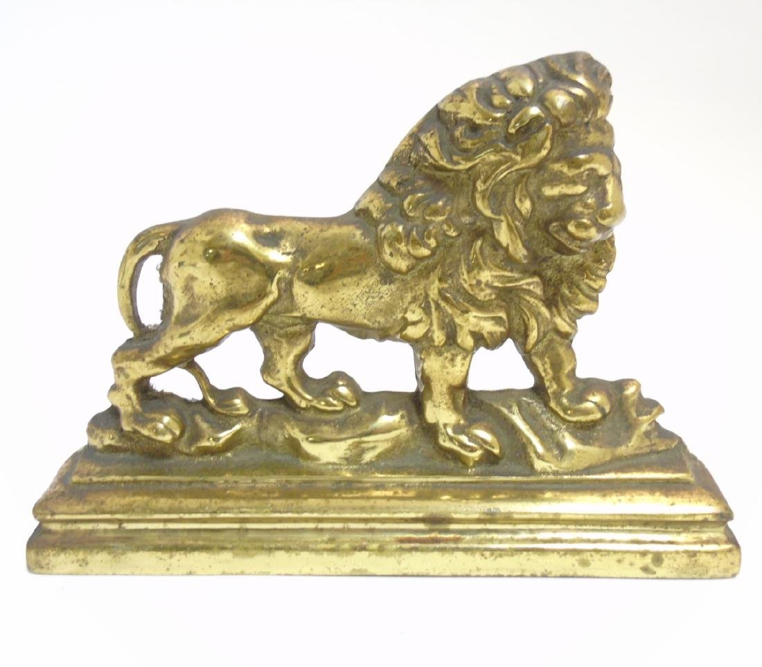 A 19thC cast brass door porter / doorstop with lion