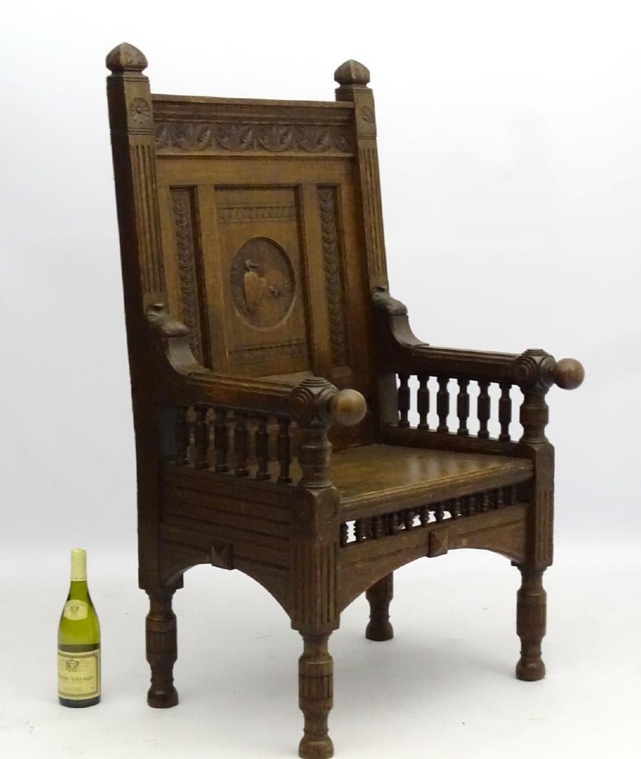 A late 19thC oak throne chair / arm chair with demi