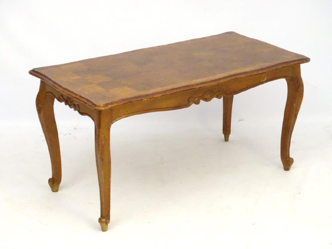 A Louis XV style oak coffee table with shaped moulded