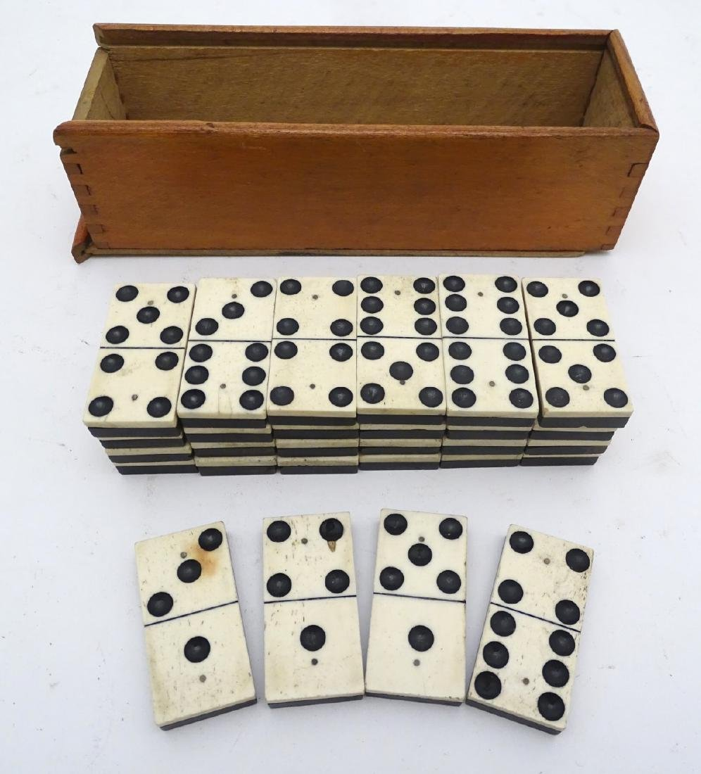 A large size set of half bone, half ebony dominoes, in