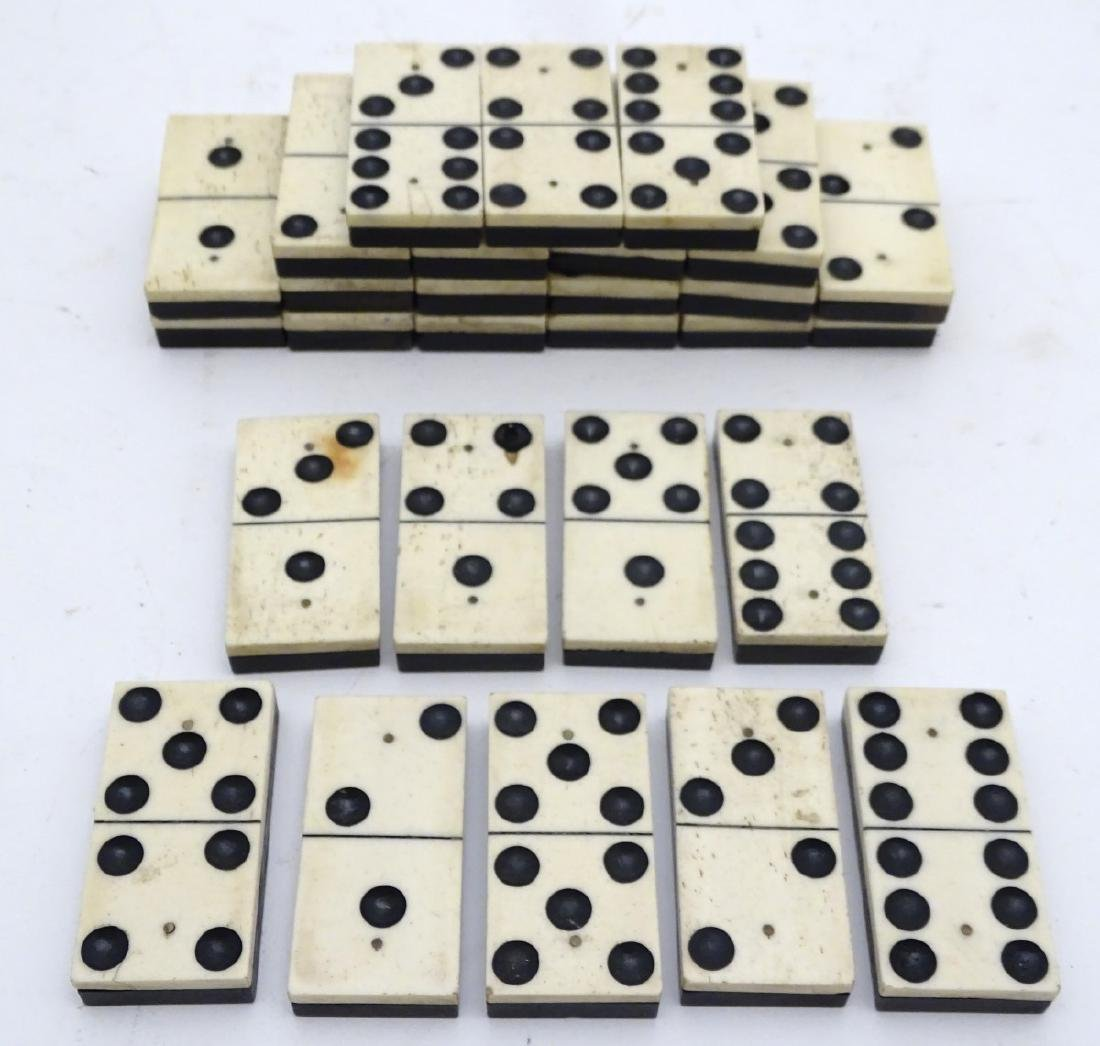 A large size set of half bone, half ebony dominoes, in - 7