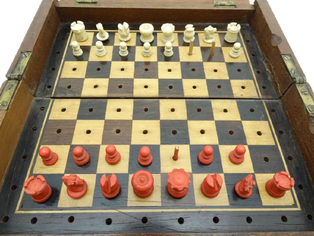 A quantity of chess pieces together within a travelling - 5