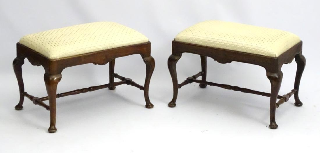 A pair of 18thC walnut stools with drop in seats and