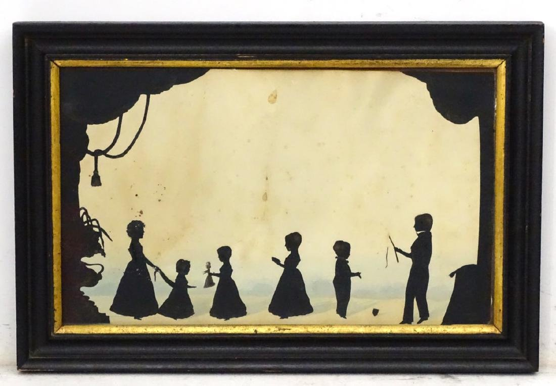 Early family cut silhouette conversation piece, c1820,