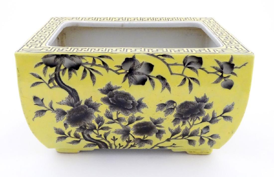A Chinese yellow oblong planter decorated with black