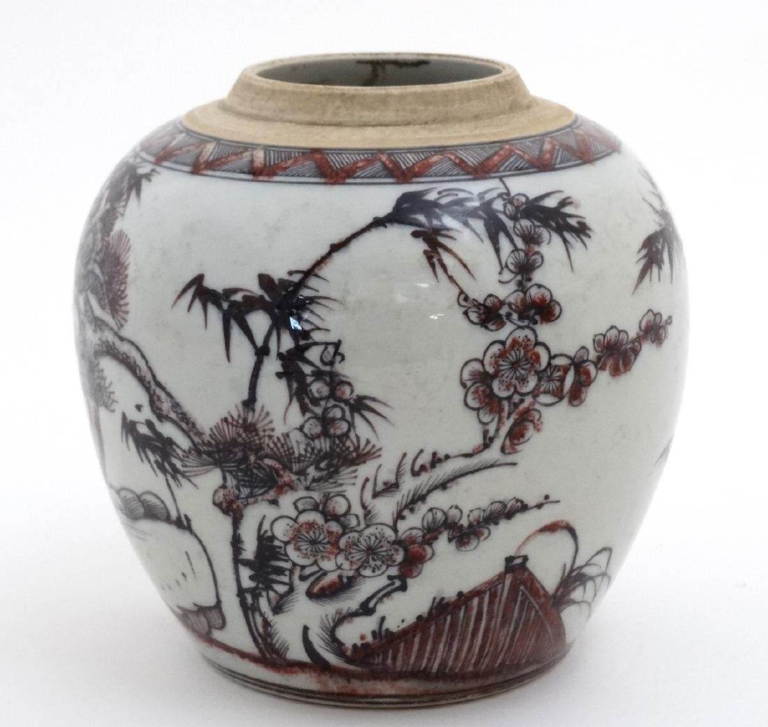 A Chinese red, black and white vase decorated with