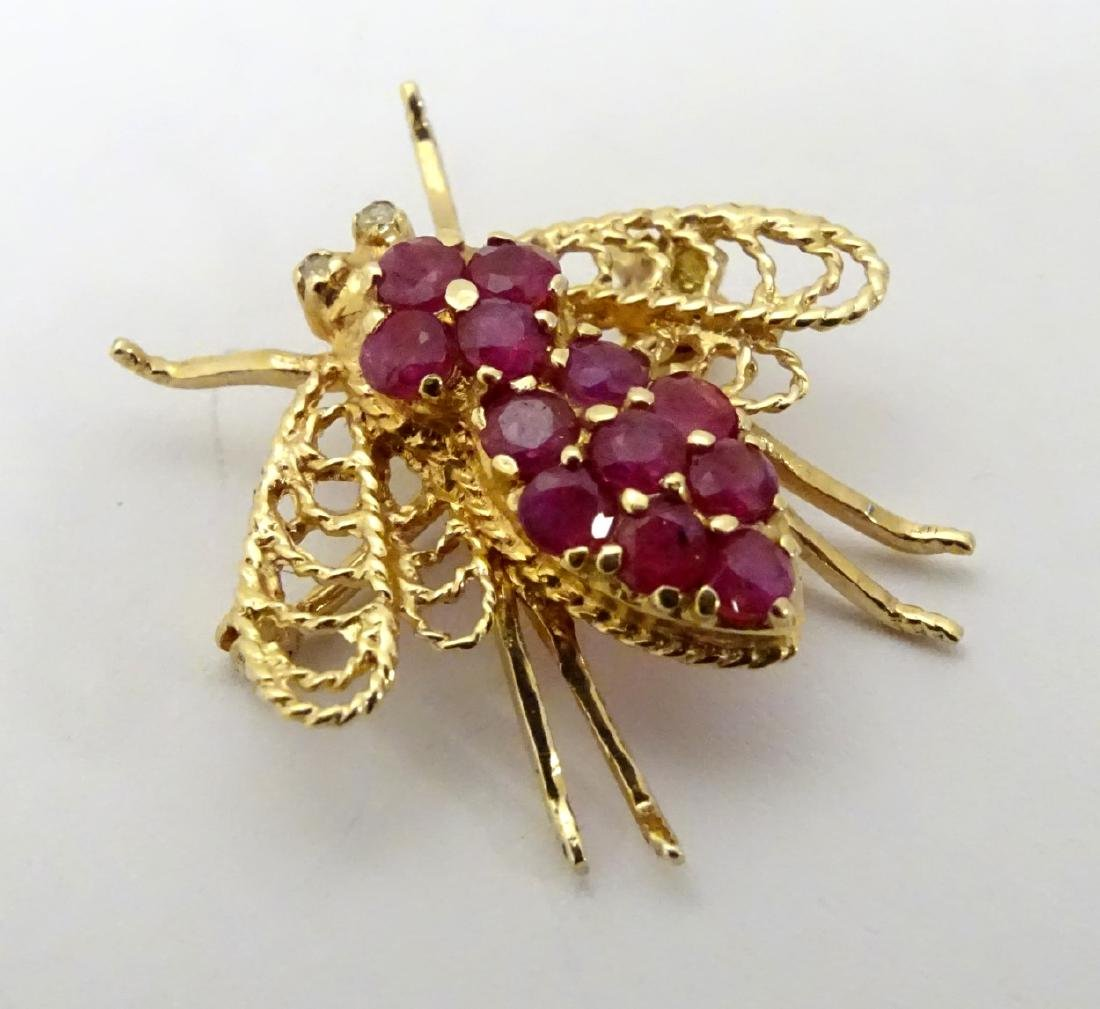 A 14ct gold brooch formed as a bee set with rubies. ¾''