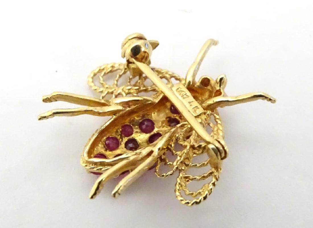 A 14ct gold brooch formed as a bee set with rubies. ¾'' - 4