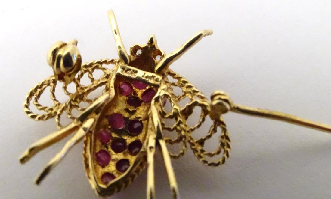 A 14ct gold brooch formed as a bee set with rubies. ¾'' - 5