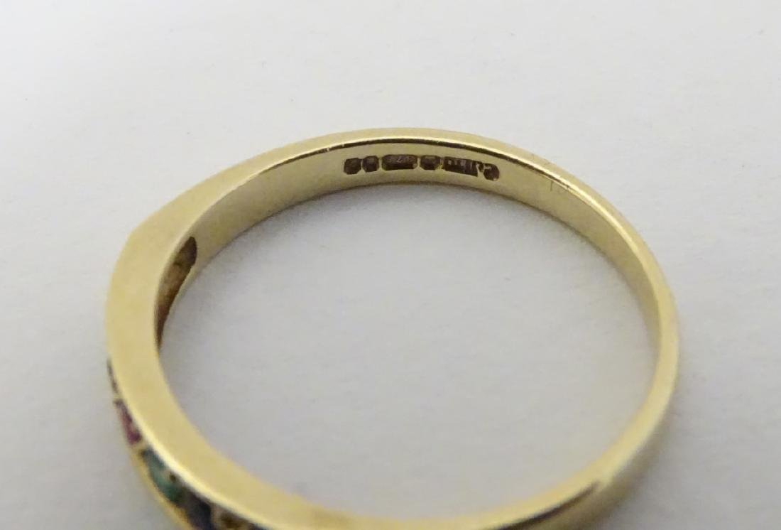A 9ct gold ring set with band of coloured stones - 2
