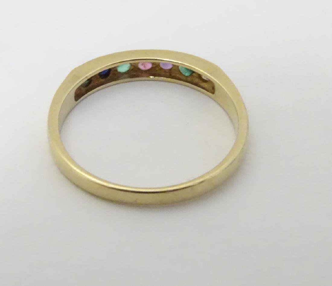 A 9ct gold ring set with band of coloured stones - 3