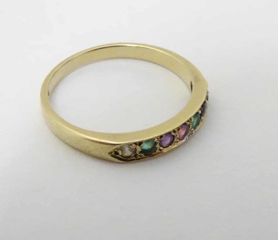 A 9ct gold ring set with band of coloured stones - 4