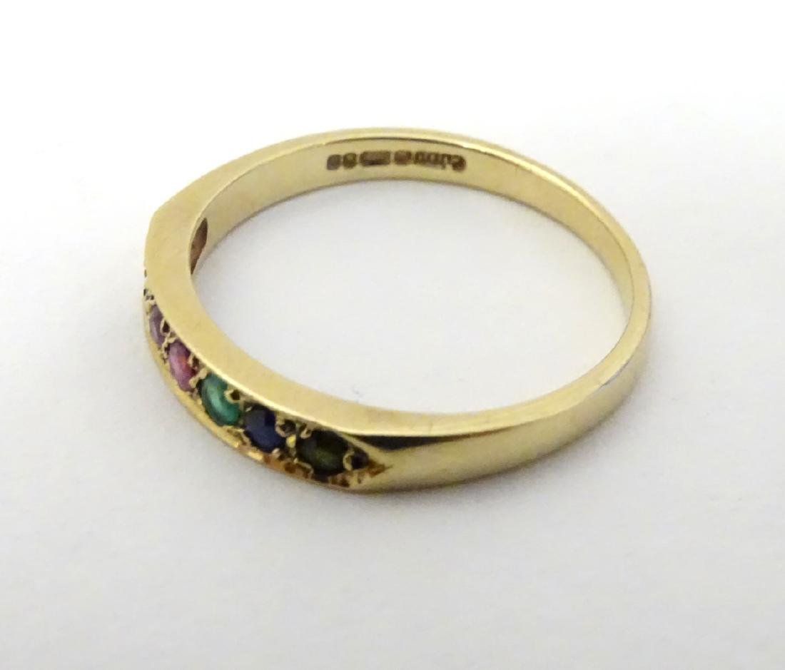 A 9ct gold ring set with band of coloured stones - 5