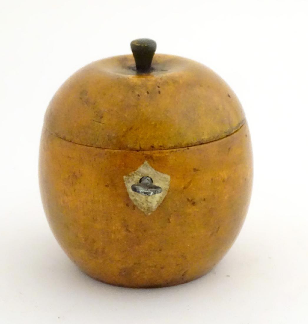 A 21stC tea caddy formed as an apple 4 1/2'' high