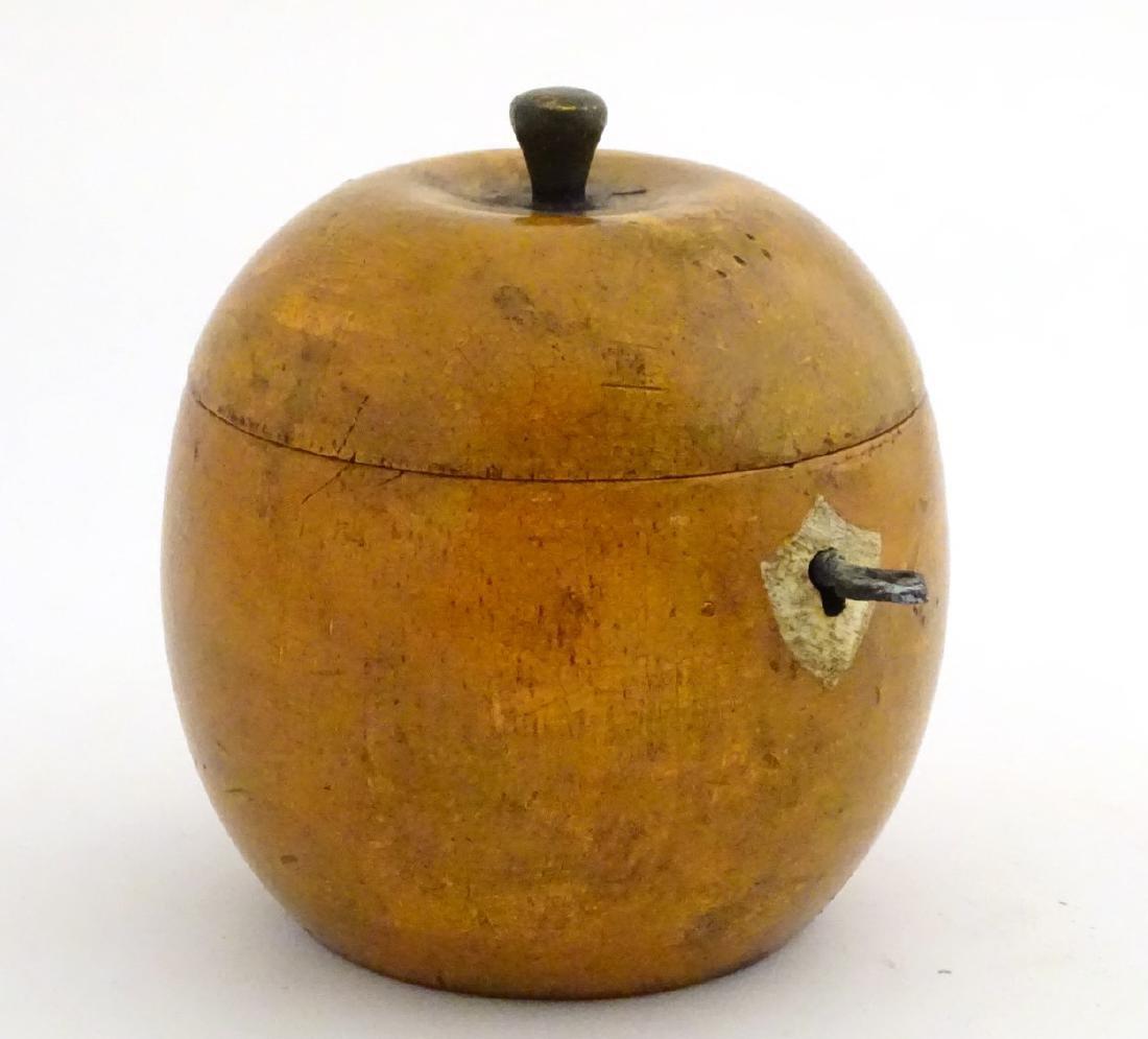A 21stC tea caddy formed as an apple 4 1/2'' high - 3