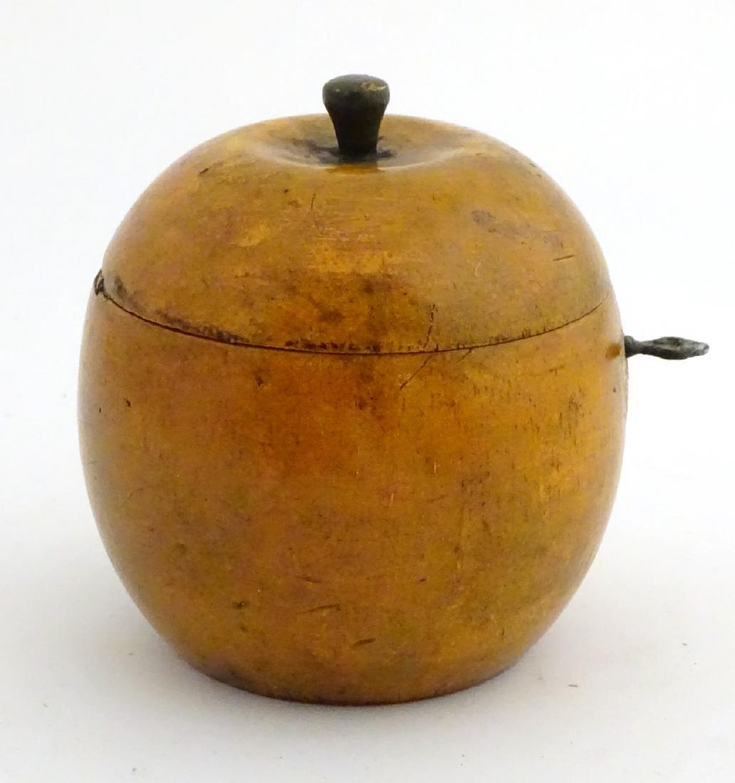 A 21stC tea caddy formed as an apple 4 1/2'' high - 6
