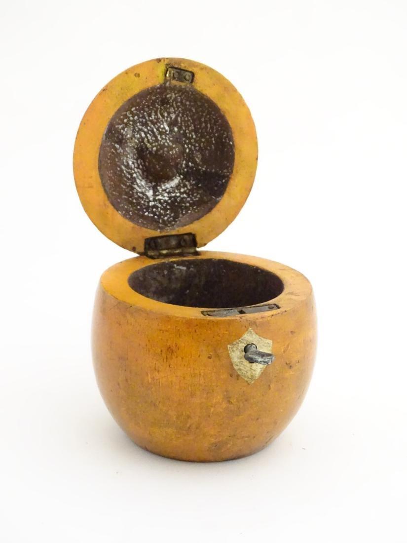 A 21stC tea caddy formed as an apple 4 1/2'' high - 8