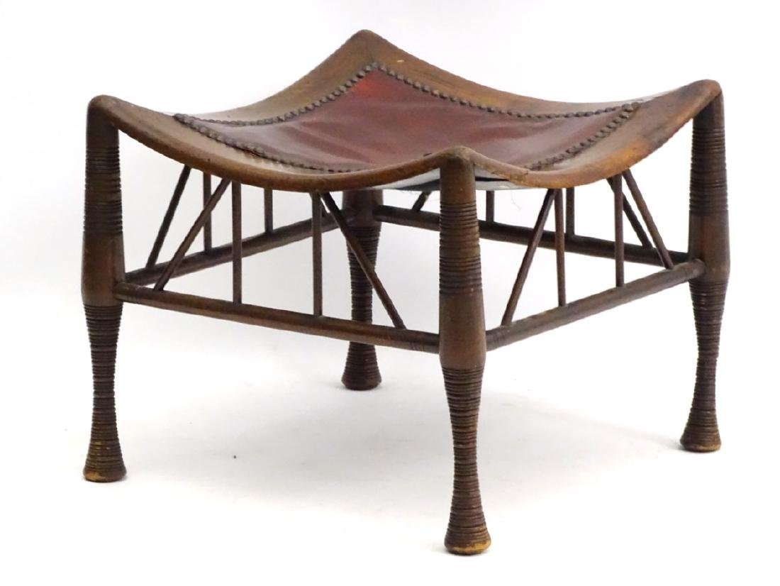 A late 19thC Egyptian revival Thebes stool in manner of