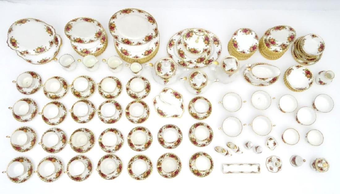 A large quantity of Royal Albert dinner wares in 'Old