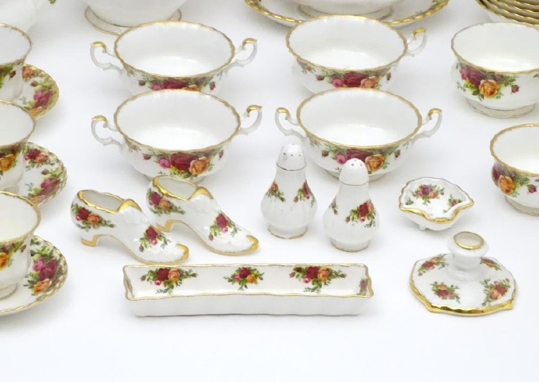 A large quantity of Royal Albert dinner wares in 'Old - 7
