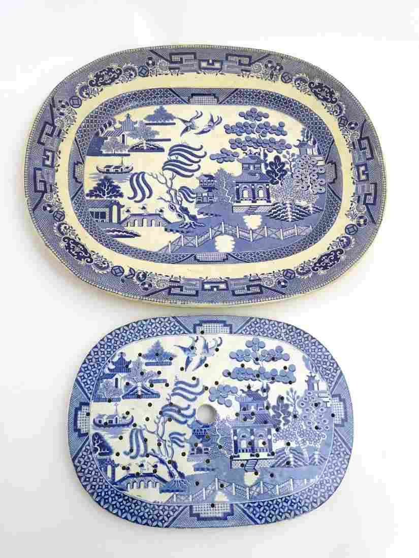 A blue and white Willow pattern oval meat plate and