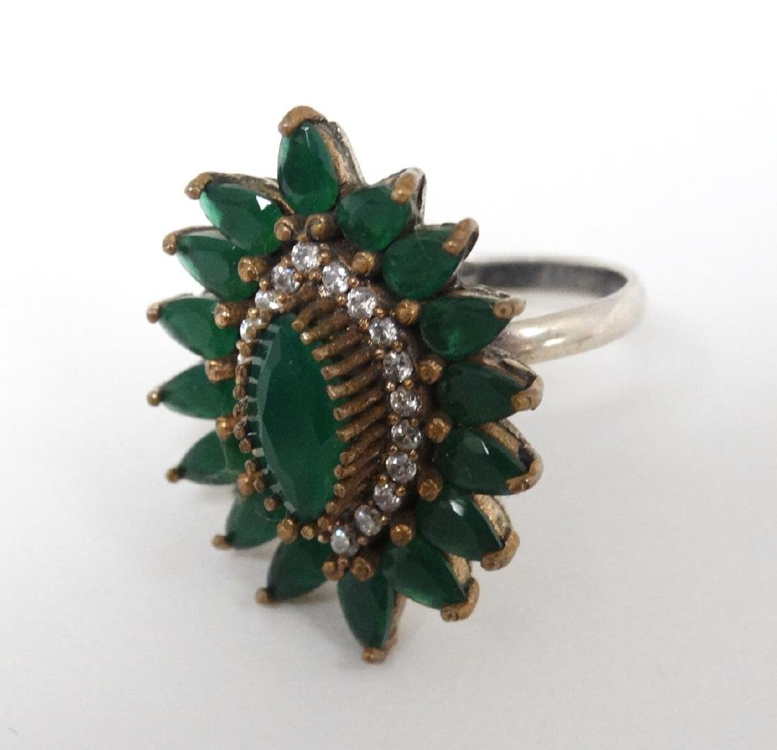 A silver dress ring in the Indian style,  set with