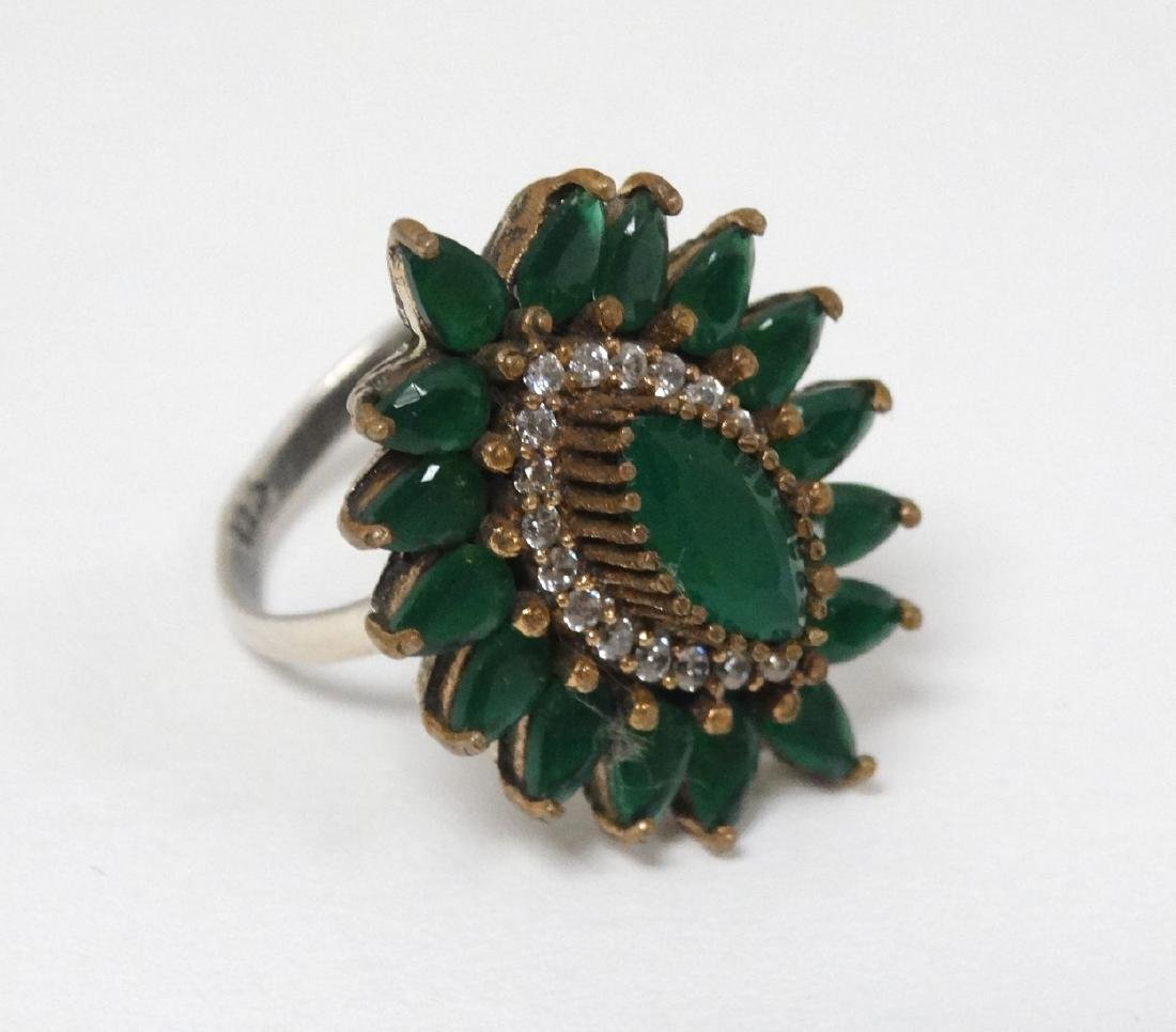A silver dress ring in the Indian style,  set with - 3