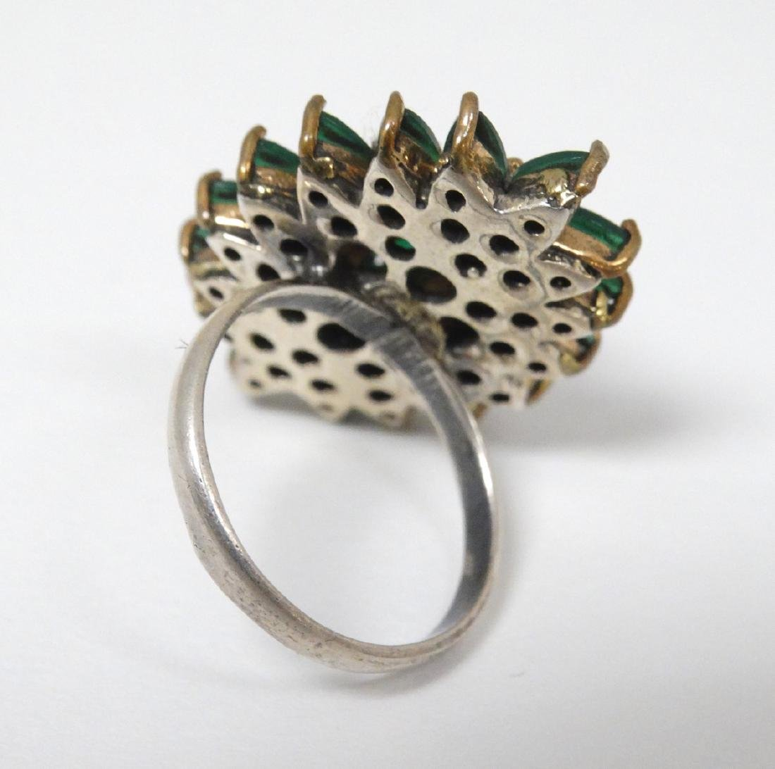 A silver dress ring in the Indian style,  set with - 4